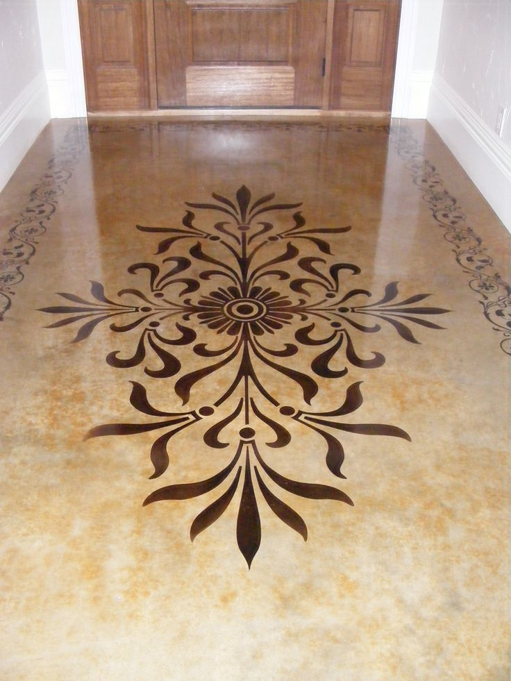 Modello Stencil on acid stained concrete flooring.  Makes for an elegant entry way.