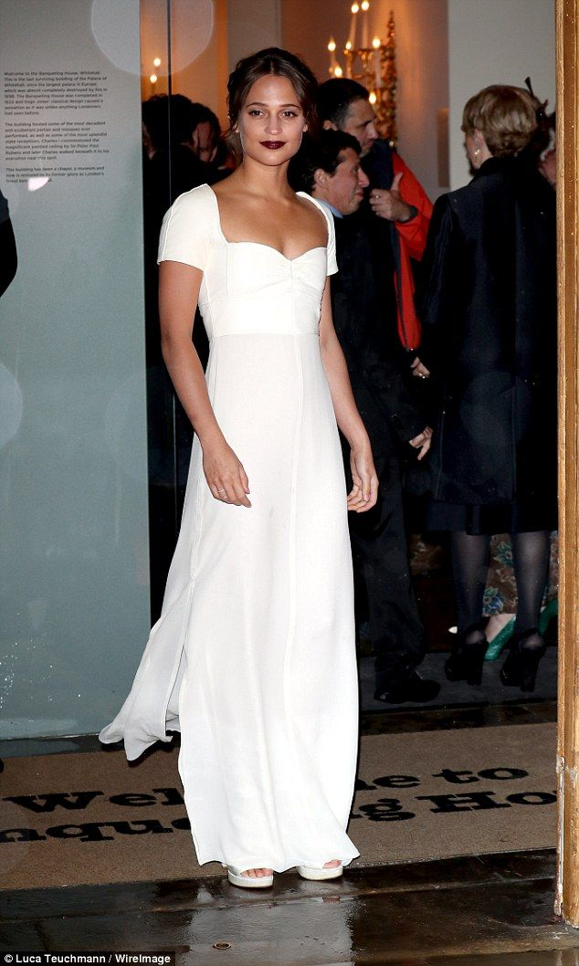Dazzling: The star soon regained her composure and was later spotted looking typically stunning in her slim fitting gown with sweetheart neckline.