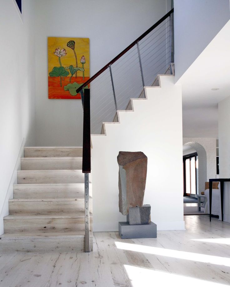 Contemporary Staircase With Light Toned Wood Steps And Stylish Cable Railings Whitewashed Floors Of Interior