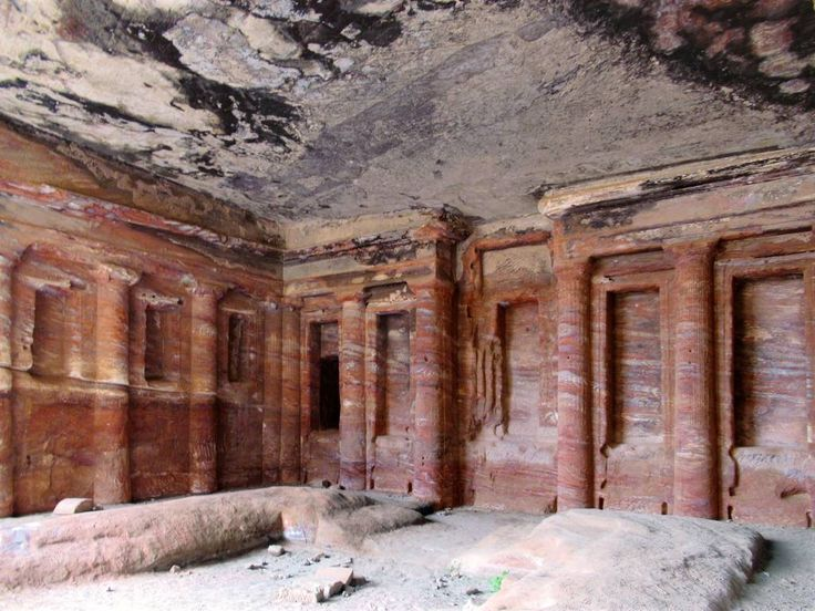 The Colored Triclinium at Petra, Jordan, is unique for the architectural decorations carved into the striated sandstone. It originally served as a funerary banqueting hall.