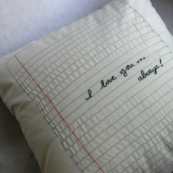 Notebook Paper Pillow   ~   Special features of the notebook paper pillow:    • hand embroidered message saying ANYTHING you want (up to 10 words)  • machine stitched notebook paper  • pillows are 14X14 with 100% polyester form inside  • front is an off-white thick cotton fabric  • back is a solid black fabric