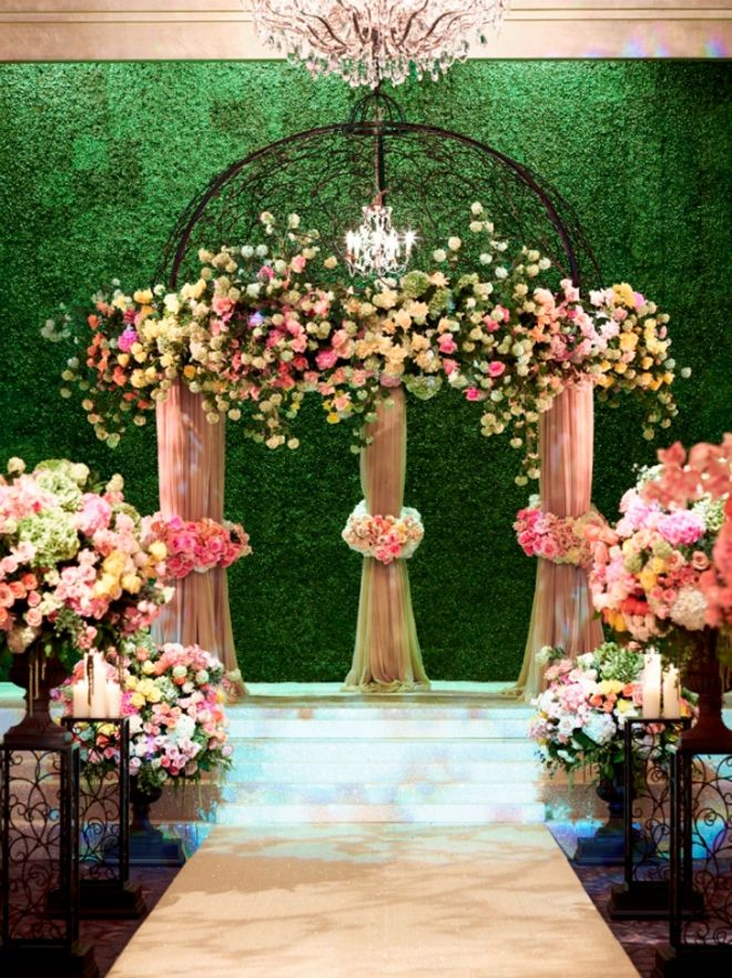 Amazing flora arch d cor with staggered height urns filled for Archway decoration ideas