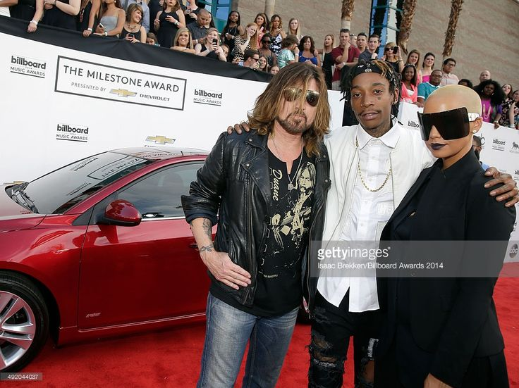 Recording artists Billy Ray Cyrus, Wiz Khalifa and model Amber Rose attend the 2014 Billboard Music Awards at the MGM Grand Garden Arena on May 18, 2014 in Las Vegas, Nevada.