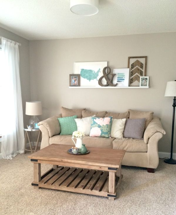 Living Room Makeover with weathered wood, green, blue, white accents, and ledge gallery wall