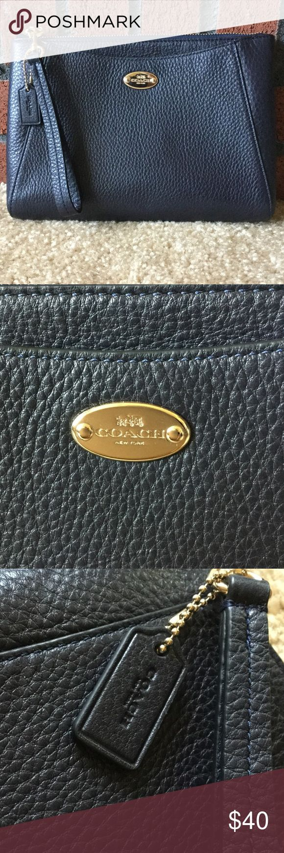 NWOT Coach Navy Blue Wristlet/Small Bag Brand New Never Used Navy Blue Coach Wristlet/Small Bag, large enough to fit a regular full size wallet and sunglasses comfortably, comes with key tag and pull zipper, front pocket to fit a cell phone as seen in picture Coach Bags Clutches & Wristlets