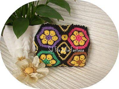 Sul filo della fantasia: Anche se siamo fuori periodo....la pochette di cotone con piastrella African Flower ci piace assai......o no????????