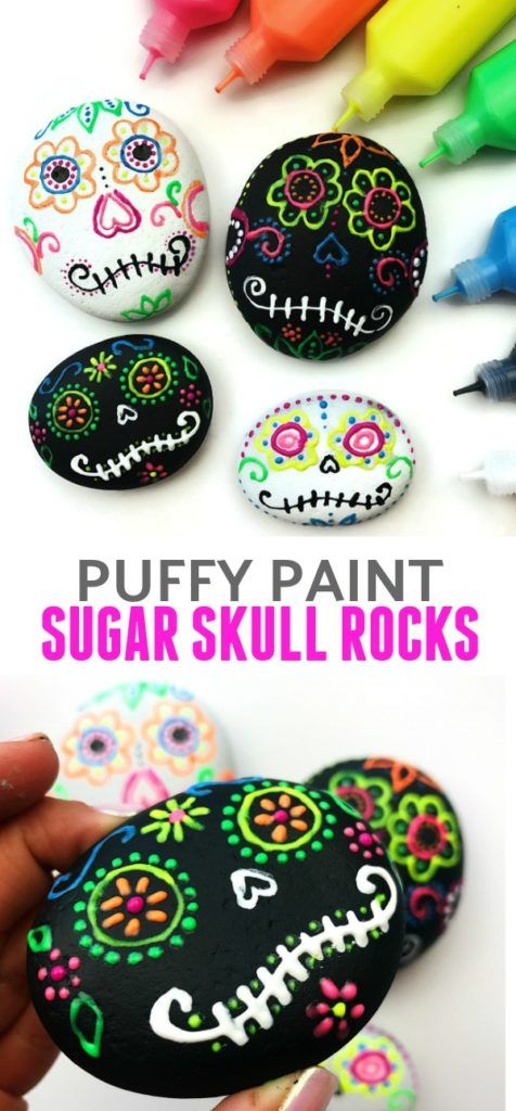 Puffy paint sugar skull rocks. This is a great craft for Day of the Dead or Dia de los Muertos. #paintedrocks #rocks #rockcraft #sugarskulls