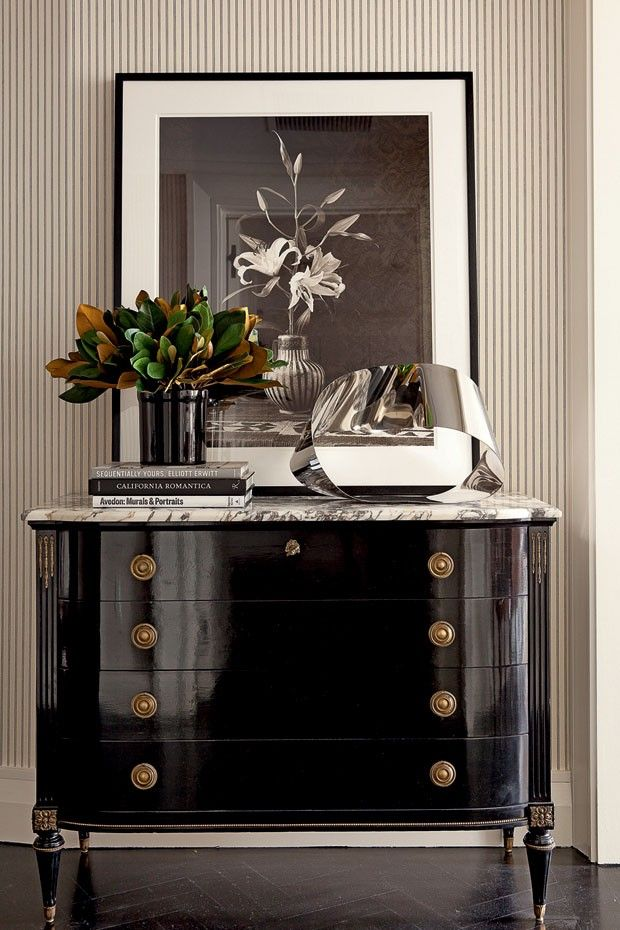Black lacquered chest of drawers with Calacatta stone top - Upper West Side residence designed by Luiz Bick and William Simonato; via Casa Vogue