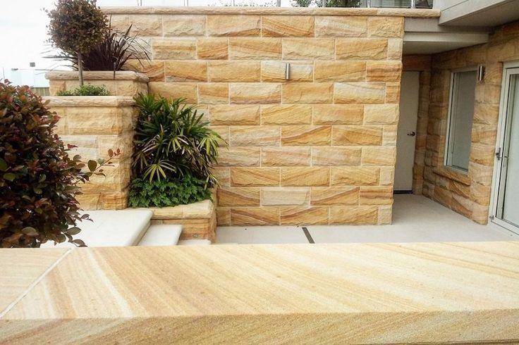 Stone wall. Sandstone cladding. Sandstone quarry. Natural stone cladding. Rockface sandstone. Sandstone wall. Sandstone house. Sandstone blocks. Sandstone tile. Sandstone floors. Australian sandstone . Sydney sandstone.