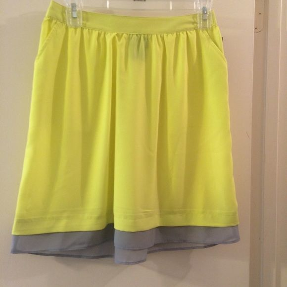 "Neon Yellow Skirt Perfect for spring/summer! Color is a neon yellow but it's not an ""in your face neon."" It's a little see though so a slip would be a smart decision to wear with the skirt. Mossimo Supply Co Skirts Mini"
