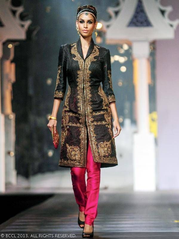 Amruta Patki showcases a creation by designer Raghavendra Rathore during India Bridal Fashion Week '13, held at Grand Hyatt, in Mumbai.