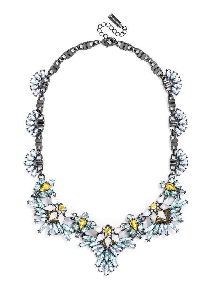 A feminine, floral statement evokes fairy wings with delicately feathered stone work.