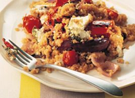 Quinoa, a nutritious grain from South America, has a texture similar to split lentils when cooked. It contains more protein than any other grain and is also lower in carbohydrate content. Here it is combined with grilled zucchini, peppers, cherry tomatoes and onions, then baked with tangy goat cheese on top. Serve with a mixed leaf salad.