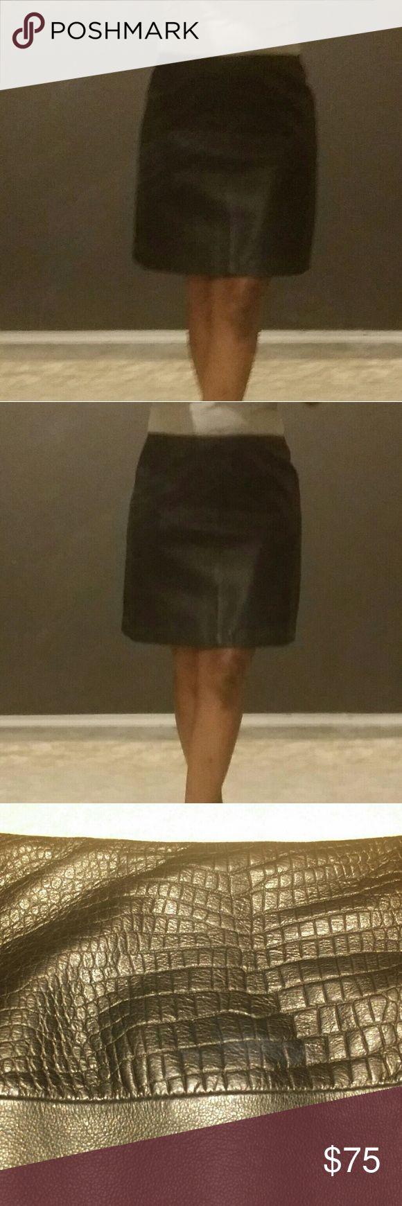 Tahari Black Leather mini skirt Super cute soft leather mini shirt by Tahari. It has crocodile print at the top. Prefect for an elegant evening out. Tahari Skirts Mini