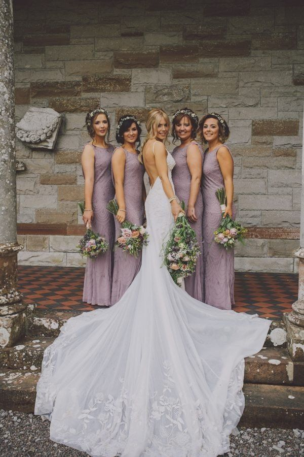 amazing wedding photo with backless dress and lavender bridesmaid dresses