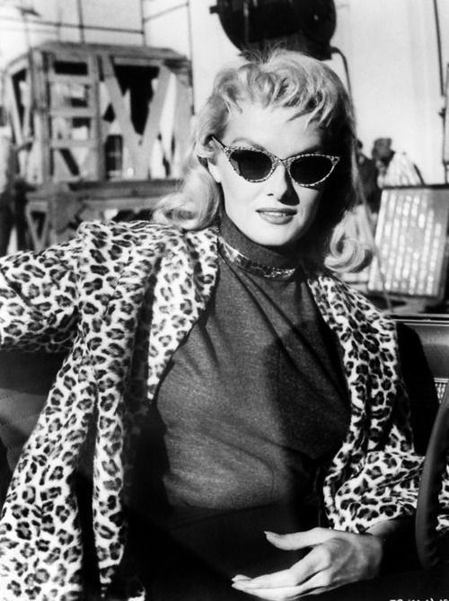 The incredible Jane Russel, in leopard print coat and specs.