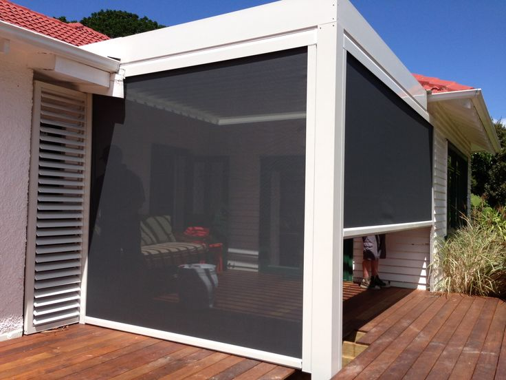 Mesh shade blinds used for weather and privacy protection creating your ultimate outdoor room.