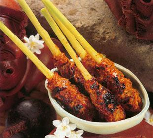 Satay Lilit (ground chicken with chili and spices formed around a lemongrass stick and grilled.)