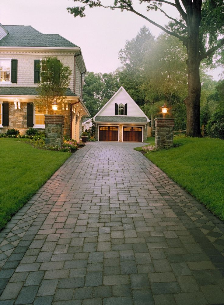 1. Block design to top of driveway. Note detaiing on house matches detailing on garage. Posts and lights with small beds by the entrance.