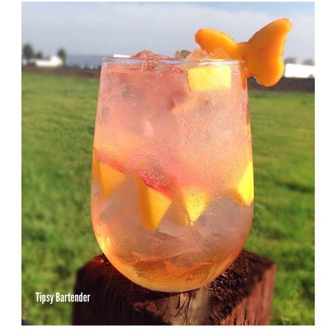 Pink Fairy Friday! 1/2oz Malibu Rum 1/2oz Watermelon Pucker 1/2oz Sweet Revenge 1/2 cup diced mangos 1 lemon wedge 1oz white cranberry juice Top with squirt soda. Enjoy!