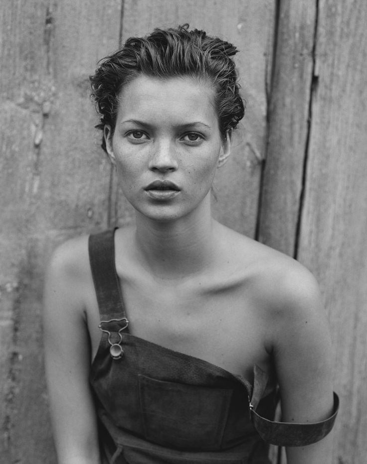 Peter Lindbergh's photography is my idea of female allure. His subjects seem to express all natural modelesque postures, poses, and facial expressions. Kate Moss, who is the subject of this portrait-like photograph, is physically flawless- contrary to her bib-overalls, which are draped sensually off of her shoulder.