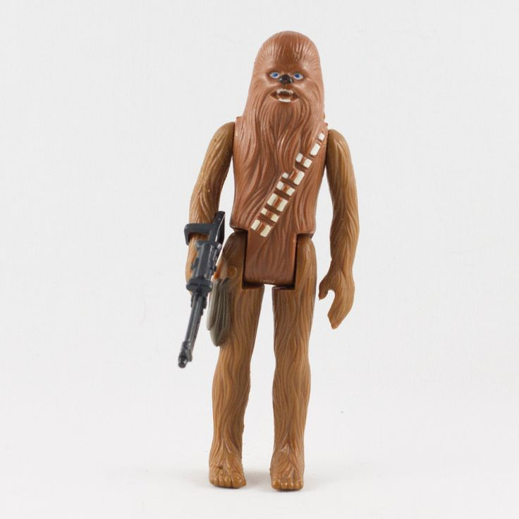 Chewbacca, This vintage Kenner Star Wars Chewbacca action figure is in fantastic condition and is an excellent addition to any collection. The limbs are very firm, allowing a wide range of poses. Although there is a bit of paint wear to Chewbacca's top row of teeth, the rest of the figure's paint finishing is crisp and sharp.  The included bowcaster weapon is a reproduction and not a Kenner original.