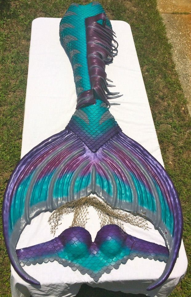 My dragon skin silicone mermaid tail and scale top in the sun made by Mernation