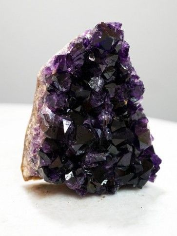 Uruguayan Amethyst Clusters - You've heard of mood lighting, but have you heard of mood...crystals? Where these Uruguayan Amethyst Clusters go, a mellow ambience follows. Set the mood by placing a cluster in your space for an atmosphere of stress-free relaxation. You can't help but give in to the soothing calm of Amethyst, especially when it comes from Uruguay—where the finest quality specimen are mined. Let Amethyst's protective aura of positivity surround you with tranquility. As the…