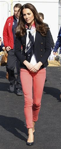 15.03.2012 During both the tour of Olympic Park and the hockey demonstration, Kate wore a pair of coral pink jeans, thought to be the Pop Slim Fit style from high street retailer Zara. For the tour of Olympic Park, Kate wore an Emilio Pucci jacket in the 'Punto Milano' style. Over a white t-shirt, Kate wore an official Team GB supporter's scarf, specifically, the scarf supporting the Paralympic team. While touring the grounds, Kate wore the L.K. Bennett 'Art' pumps,