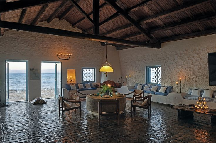 Absolute Waterfront Villa Living Room with the original olive press stone as a table. The turtle is real!