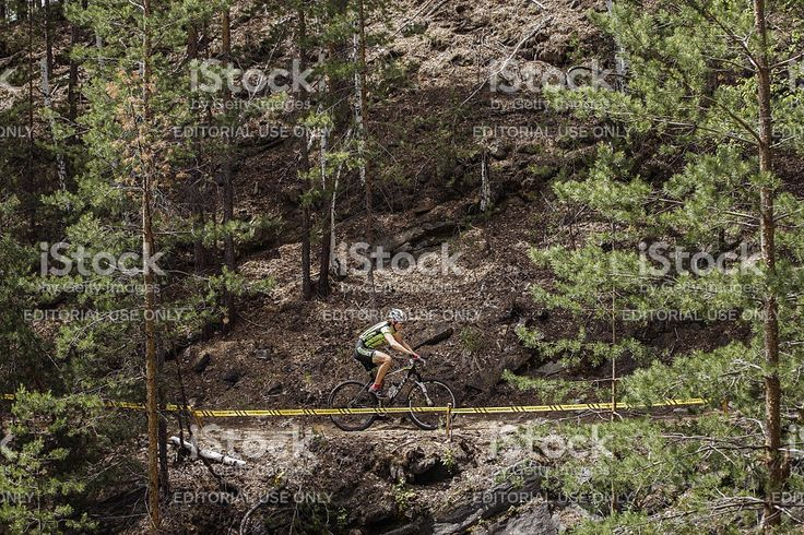 Kyshtym, Russia - June 16, 2016: General plan of a cyclist riding along mountains during Championship of Russia on mountain bike
