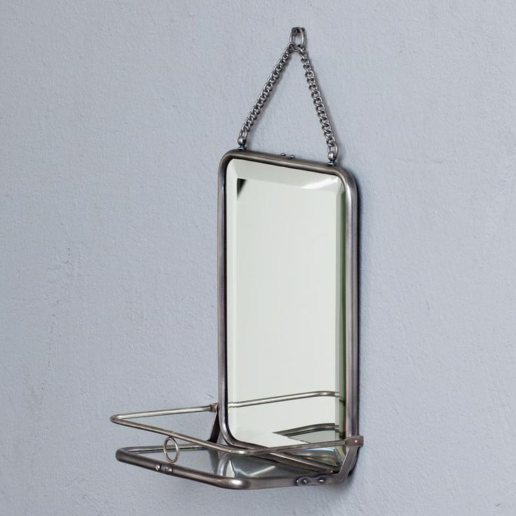 Bathroom mirror with vintage shelf