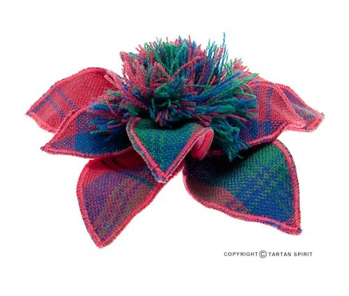 Wool corsage makes an ideal accessory to add a touch of tartan to any outfit. These are made with wool tartan, with a pin on the back to attach to a lapel of a jacket or the neck of a jumper it's just a great simple look. These can also be attached to a bag or a skirt or anywhere!