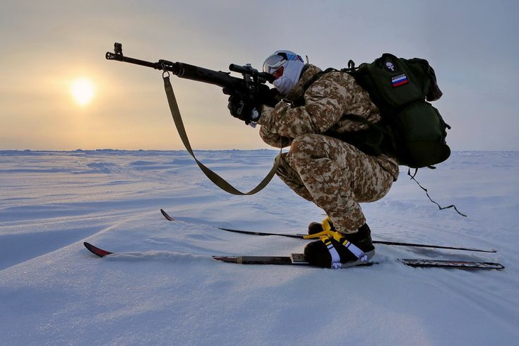 Russian VDV special forces soldier aims down the scope of his SVD during training in the Arctic