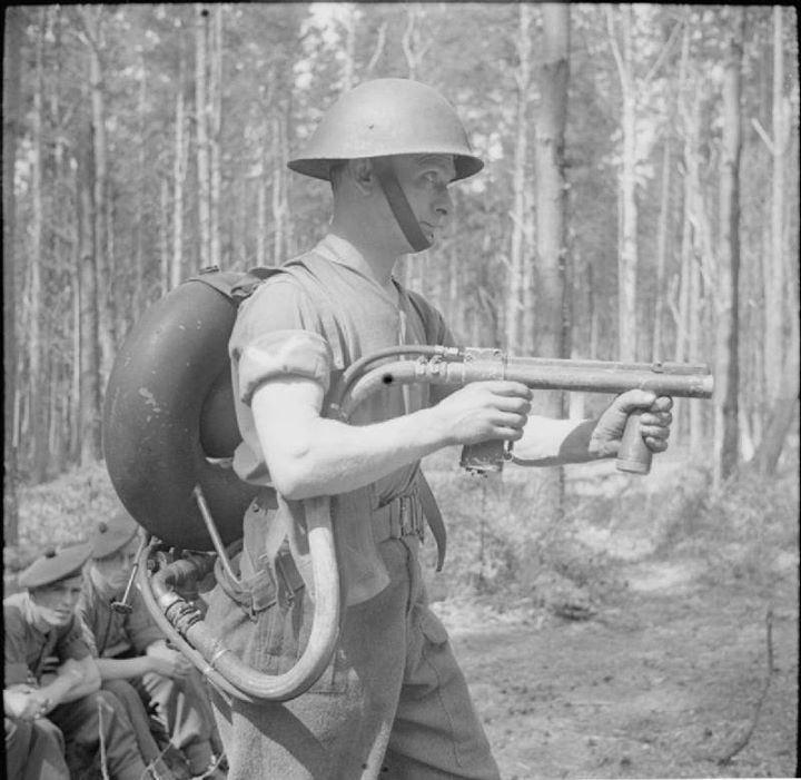 A soldier with 1st Battalion King's Own Scottish Borderers demonstrates the Lifebuoy man-portable flamethrower Denmead Hampshire 29 April 1944.