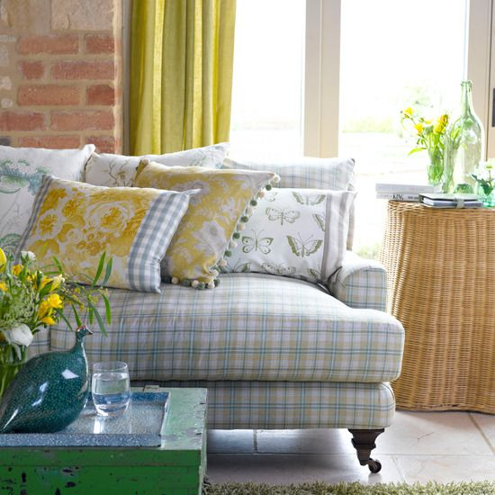 exposed brick wall, blue plaid and yellow accents... LOVE