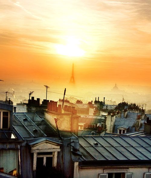 Paris rooftops with the Eiffel Tower in the distance