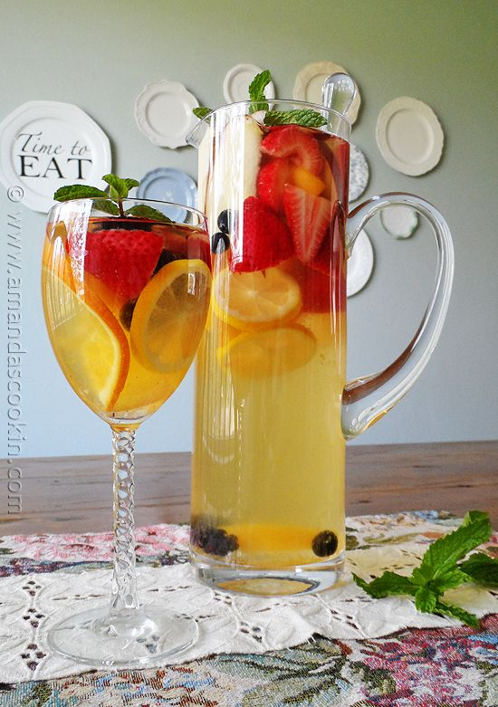 ~SPECTACULAR SANGRIA~ Ingredients: •1 bottle (750 ml) Gallo Moscato •1/2 cup orange liqueur (like Triple-Sec) •1 liter club soda •1 peach, sliced •1 medium apple, sliced •1 orange, unpeeled and sliced •1 small lemon, unpeeled and sliced •8-10 medium strawberries, stems removed and halved •16 blueberries •16 blackberries •Fresh mint for garnish (optional)