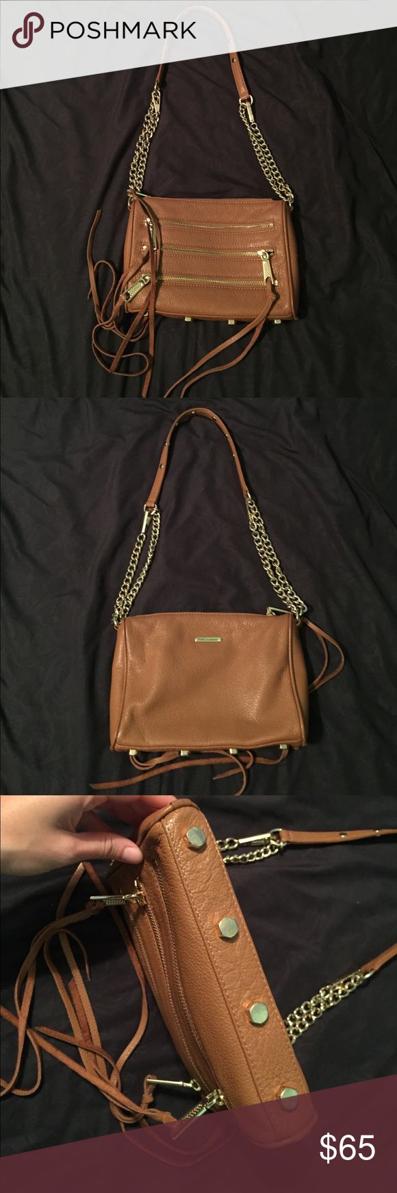 Rebecca Minkoff 5 zip crossbody This bag is in great condition. Just selling because I have too many purses! The chain is adjustable to make it crossbody length or shoulder length. I even have extra replacement tassels. Rebecca Minkoff Bags Crossbody Bags