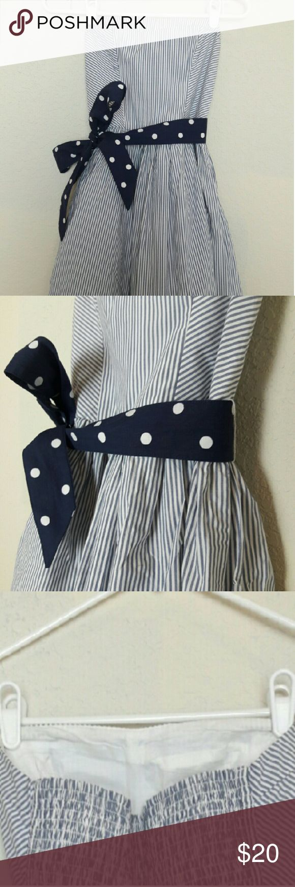 Hollister Strapless Nautical Cocktail Dress ADORABLE! Never worn dress! Suttle sweetheart neckline and ballgown like bottom. Sits about mid thigh. Polka dot waistband helps accentuate the waist! Very slight discoloration on inner bust line from sitting in closet (in third picture). Hollister Dresses Strapless