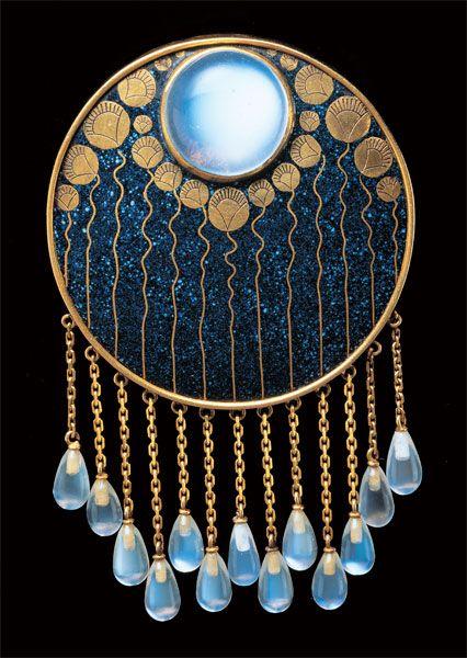 Austrian Jugendstil design of night-blooming lotus by Ferdinand Hauser: Gold, enamel moonstone brooch. ca. 1900 | JV