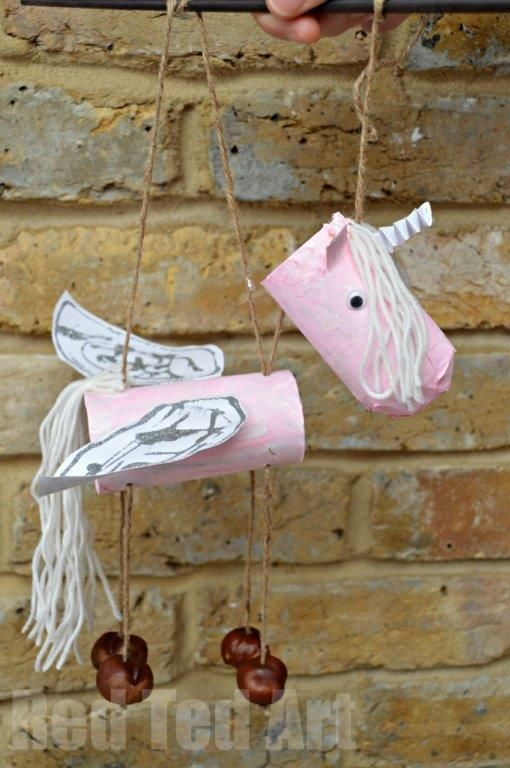 TP Roll Unicorn Crafts - a super cute DIY for kids - turn the humble cardboard tube into this adorable Unicorn Marionette!