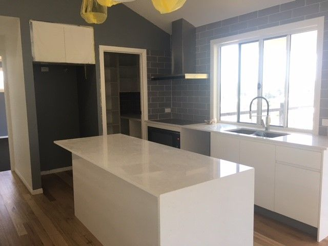 Modern Kitchen With Stone Benchtops And Servery Window | Tru Built Builders  Queensland.