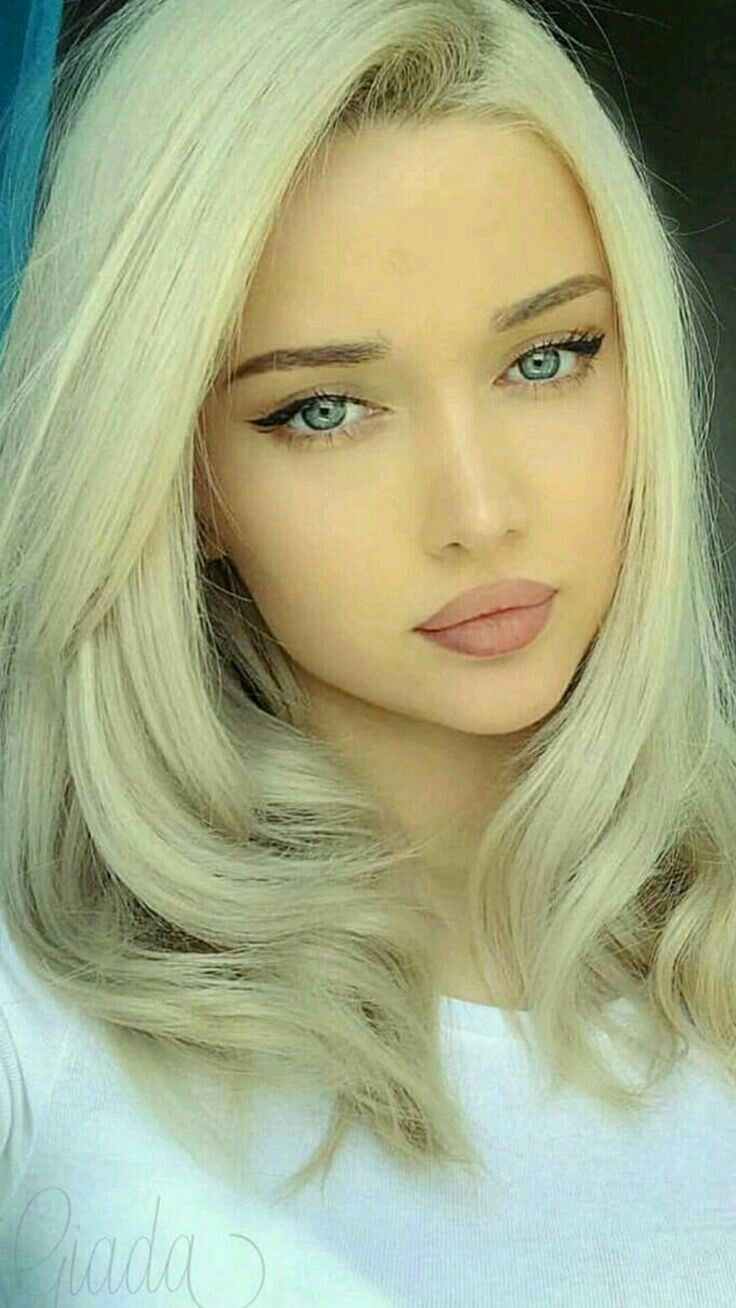 Cute Blonde Girl With Blue Eyes Looking Sweet With Her