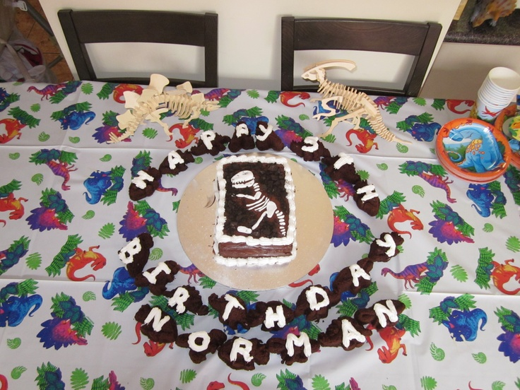 Norman's 5th Birthday cake, little cake dinos all around larger cake