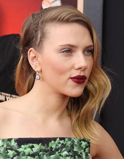 Scarlett Johansson with deep-part hairstyle with tiny side braids