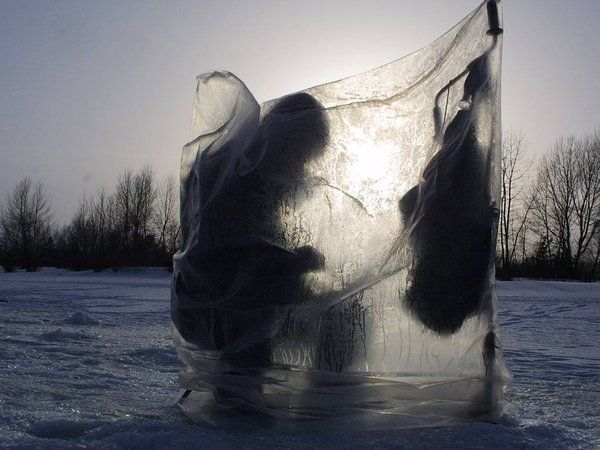 A man fishes while sitting on the ice of the river Ob March 3, 2002 in Novosibirsk, East Siberia, Russia. (Photo by Oleg Nikishin/Getty Images)
