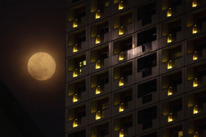 The 'Supermoon' rises at the Swissotel The Stamford over Singapore on June 23, 2013 in Singapore.
