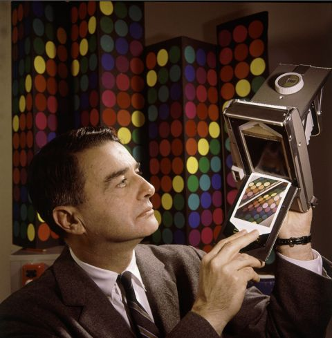 """Edwin Land, co-founder of the Polaroid Corporation, demonstrates his company's """"60-second film"""" in 1963."""