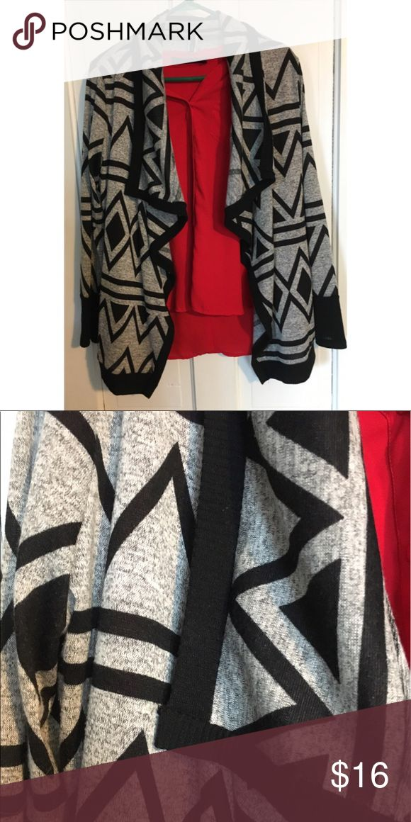 Aztec print cardigan..soft like a sweatshirt Aztec print cardigan with cascading collar..very comfortable..feels like a sweatshirt almost.size xl Sweaters Cardigans